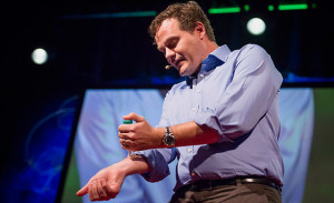 Mark Kendall is not giving himself a shot in this image! He is demonstrating how a vaccine can be delivered via a patch. Photo: James Duncan Davidson