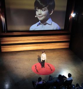 "In ""The Thought Leader,"" a satire created by artist Liz Magic Laser, 10-year-old Alex Ammerman gives a TED Talk that ponders the ""dark chasm of meaninglessness."" And he does it perfectly. Photo: Courtesy of Various Small Fires, Los Angeles"